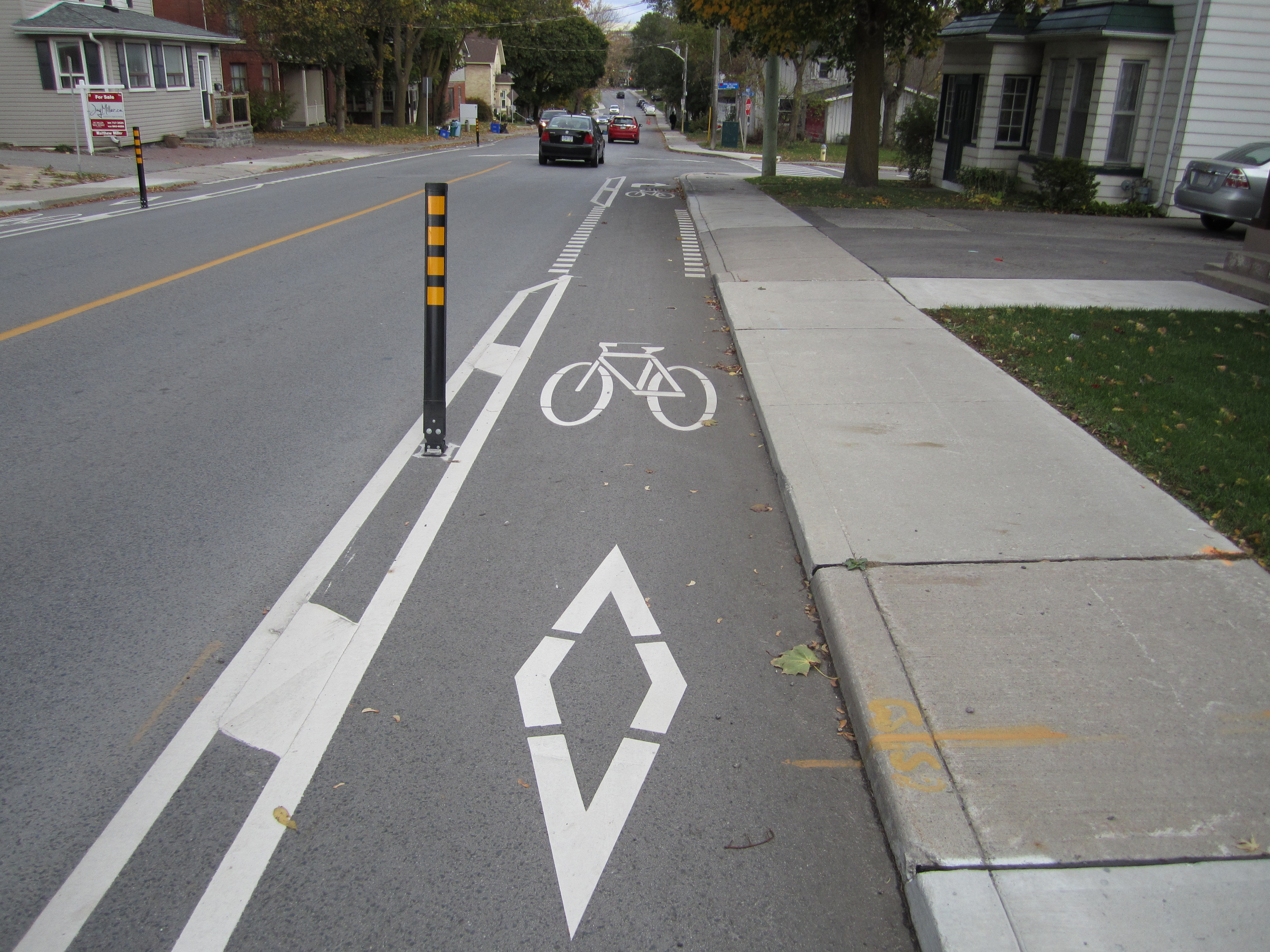 a picture showing a bicycle and diamond symbol on Prospect Street