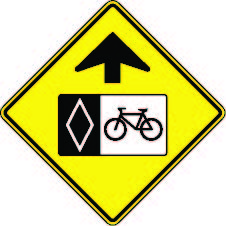 a graphic of a 'reserved bicycle lane ahead' sign