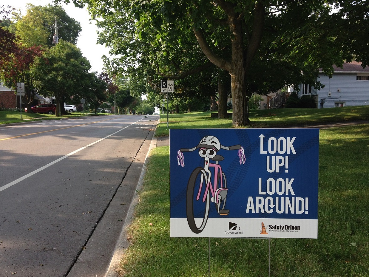 "Image of a roadside safety sign that reads ""look up look around"""