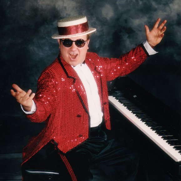 image of ron fleming at a piano
