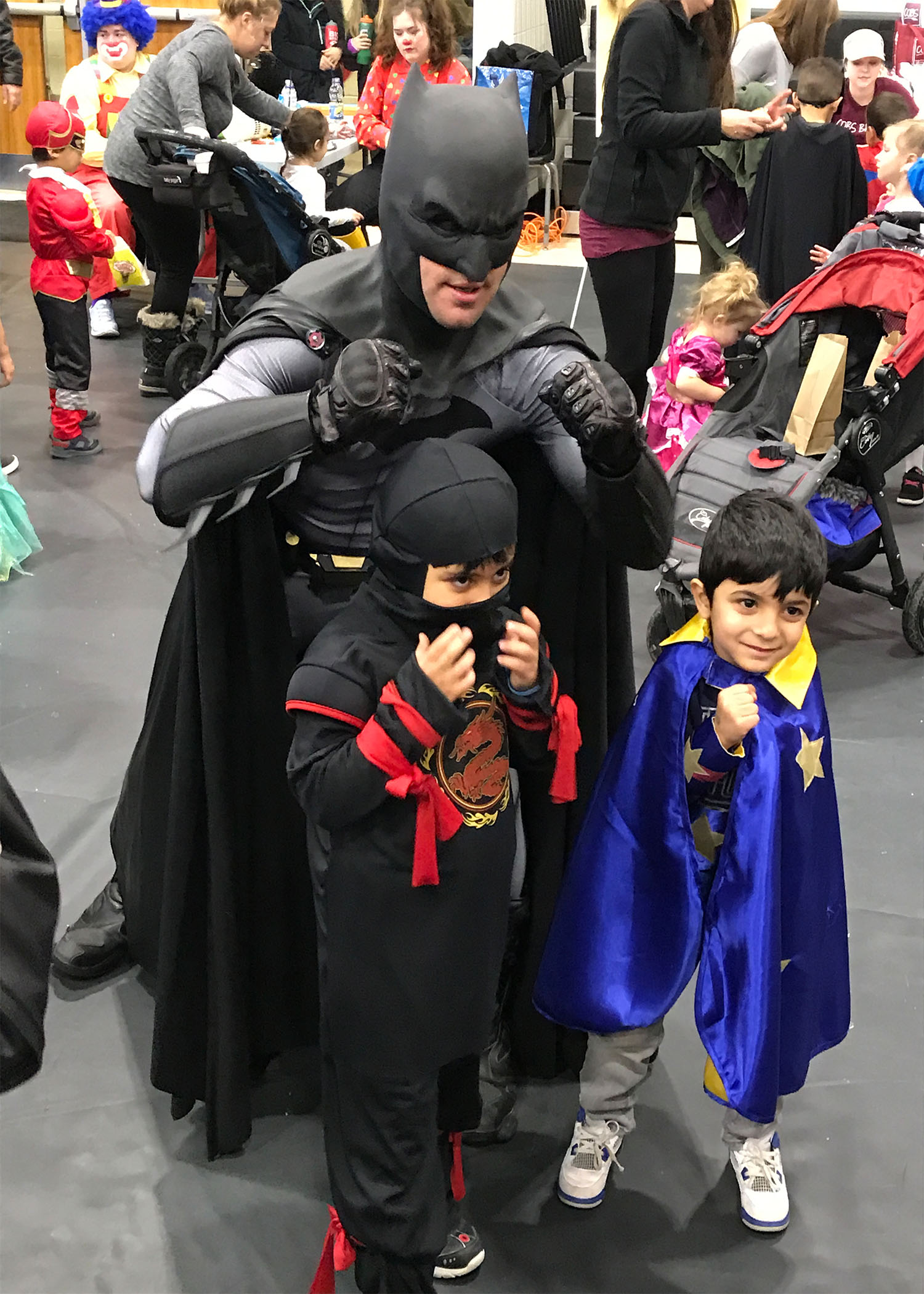Batman with two young superheros