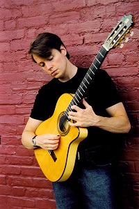 Image of David Howard with a guitar