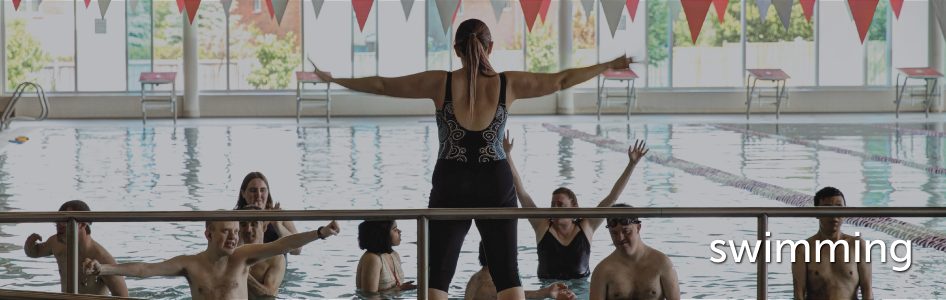image of swim instructor instructing a water class
