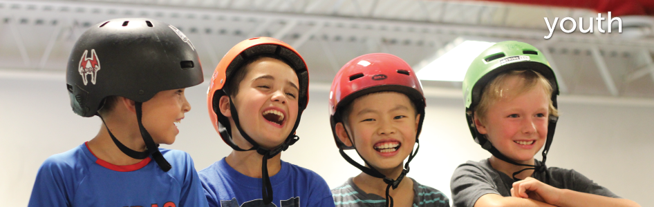image of four children laughing at the skate park